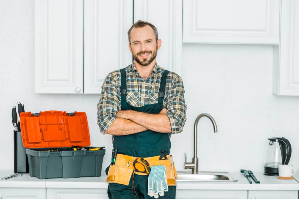 plumber standing in kitchen, plumbing tips
