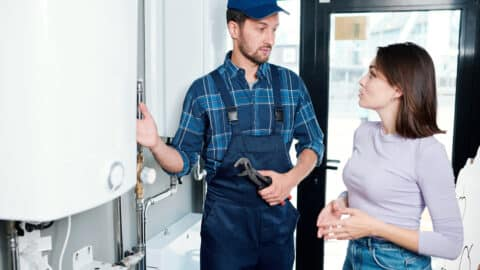 Plumber talking to home owner about plumbing tips